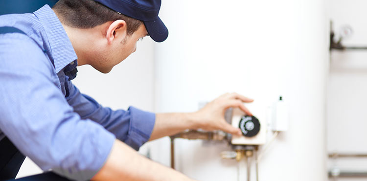 plumber repairing hot water heater